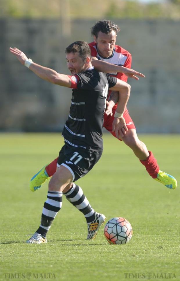 Balzan's Steve Bezzina (no.11) stops the run of Pembroke Athleta winger Manolito Micallef during their BOV Premiership match at the Hibernians stadium in Paola on February 20. Photo: Matthew Mirabelli