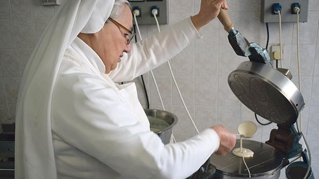 Franciscan Sister Giovantonia ladling the batter.