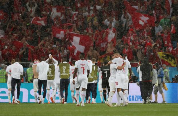 Switzerland players celebrate victory in front of their fans after the match.