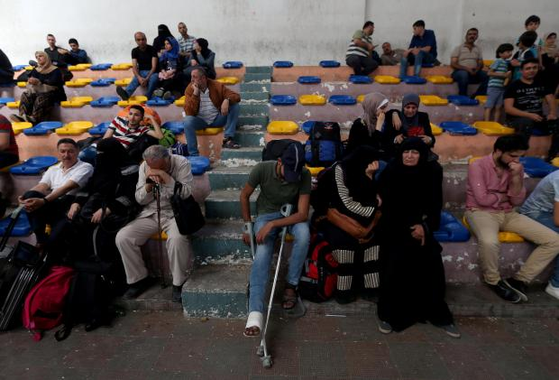 Palestinians waiting to cross the border. Photo: Reuters