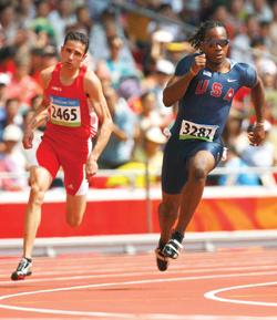 Nicolai Portelli (left) takes a bend along with American Walter Dix during yesterday's 200m heat at the National Stadium in Beijing.