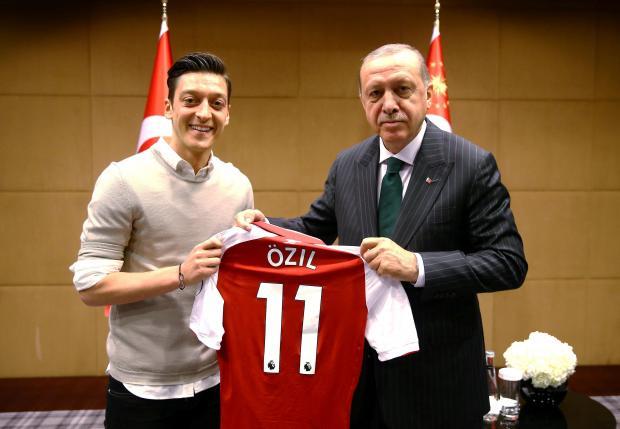 Mesut Ozil poses with Turkish President Tayyip Erdogan.