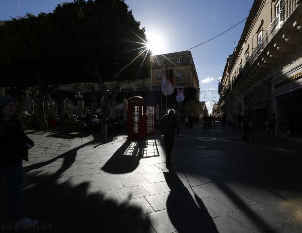 An elderly man walks across Pjazza Regina in the centre of Valletta on January 6. Photo: Darrin Zammit Lupi
