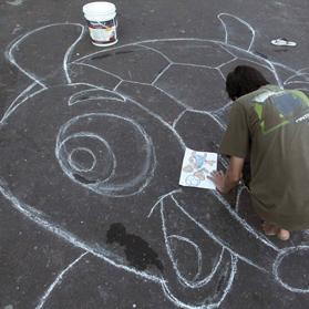 A man gets ready to paint Fuleco, the 2014 World Cup mascot, on Third Street of the Alvorada neighbourhood in Manaus, one of the soccer tournament's host cities. Photo: Bruno Kelly/Reuters