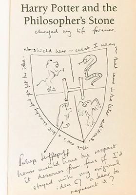 A rare first-edition Harry Potter book containing pesonal anecdotes and illustrations by J.K. Rowling which is going on display at Edinburgh's Writers' Museum. Photos: The City of Edinburgh Council/PA Wire