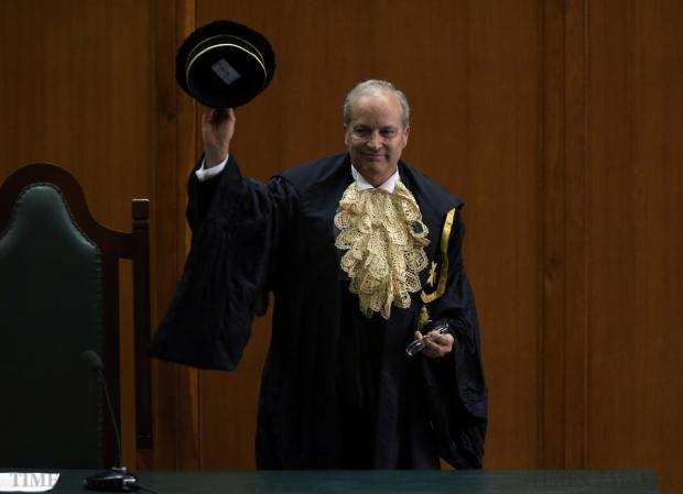 Mr Justice Michael Mallia waves after his final court sitting, bringing a 29-year career as a member of the judiciary to a close, at the Law Courts in Valletta on March 26. Photo: Darrin Zammit Lupi
