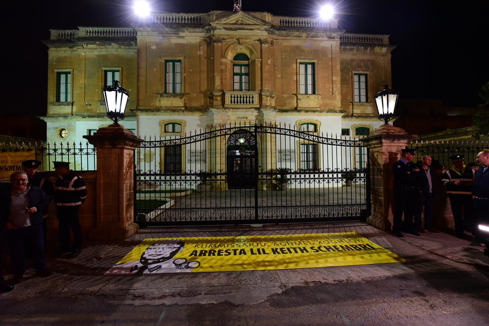 Outside police headquarters an appeal to arrest Keith Schembri. Photo: Mark Zammit Cordina