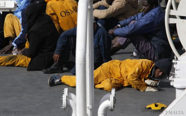 Surviving immigrants lie on the deck of the Italian coastguard ship 'Bruno Gregoretti' in Senglea, on April 20. As many as 800 migrants were feared dead on Sunday after their boat capsized in the Mediterranean, raising pressure on Europe to face down anti-immigrant bias and find money for support as turmoil in Libya and the Middle East worsens the crisis. Photo: Darrin Zammit Lupi