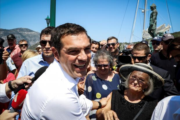 Greek PM Tsipras greets supporters on the island of Ithaca.