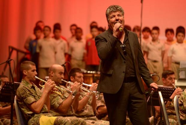 Winter Moods frontman Ivan Grech sings in the final rehearsal at the Mediterranean Conference Centre on May 26, before the Armed Forces of Malta Charity Concert in aid of the Marigold Foundation. The concert, which also includes a choir of about 80 students from De La Salle College and St Joseph School, will feature a varied repertoire of songs from Les Miserables, Phantom of the Opera and the Beatles. Photo: Matthew Mirabelli