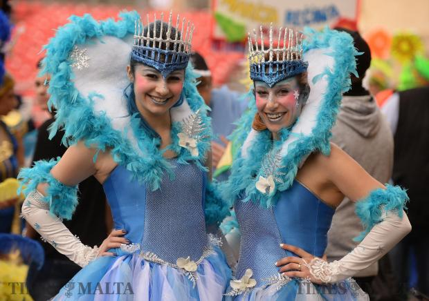 Two ladies pose before the start of the carnival dance show at St George's Square in Valletta on February 27. Photo: Matthew Mirabelli