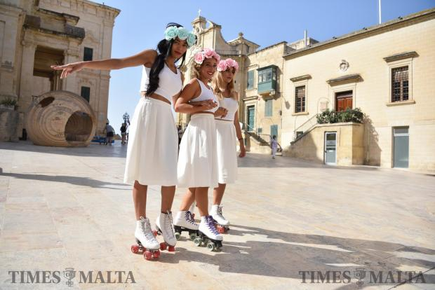 Roller skaters hold each other whilst going down a street in Valletta on July 02. Photo: Mark Zammit Cordina