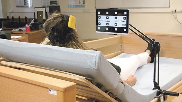 A user controlling the functions of a motorised bed using brain signals. Photo: Dr Inġ Stefania Cristina