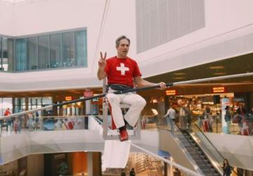Watch: Spends 8 hours sat balancing on a chair on a tightrope in shopping mall