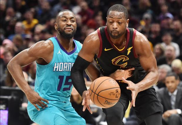 Dwyane Wade (right) in action for the Cleveland Cavaliers against Charlotte Hornets.