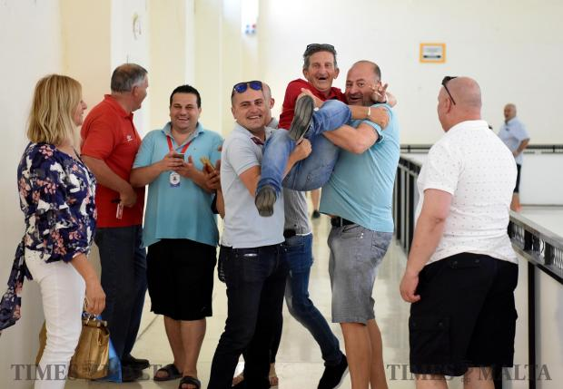 Counting agents take a moment to lift another counting agent during a casual election for the Labour Party, at the Naxxar counting hall on June 20. Photo: Mark Zammit Cordina