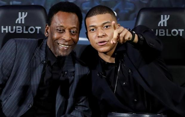 Pele (left) with French star Kylian Mbappe.