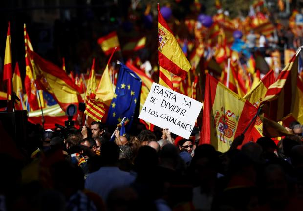 Pro-unity activists say the push for secession is fracturing the Catalan state. Photo: Reuters