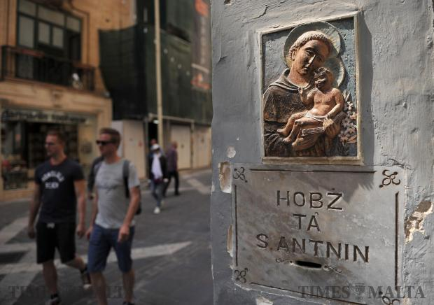 An effigy of St Anthony hangs on the wall of the church of St Francis in Valletta on May 2. Photo: Chris Sant Fournier