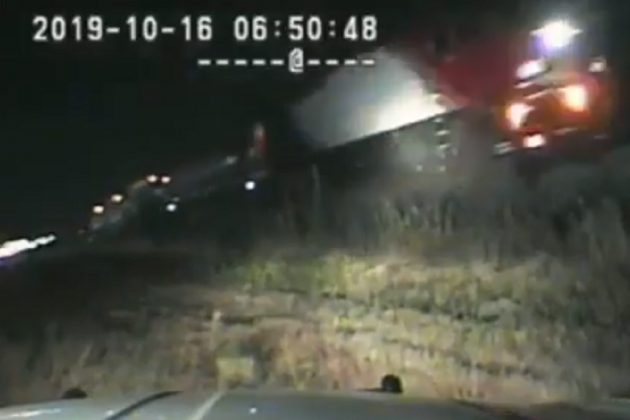 Watch: US hero cop pulls man from car seconds before train hits it
