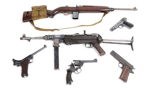 Six firearms, including a German 9mm Luger pistol, a .38 Enfield revolver and a .30 US carbine. Photo: Surrey Police/PA