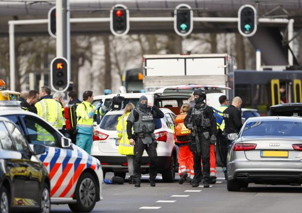 Police forces stand at the 24 Oktoberplace in Utrecht where a shooting took place.