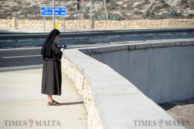 A nun takes a stroll along the Coast Road on September 18. Photo: Steve Zammit Lupi