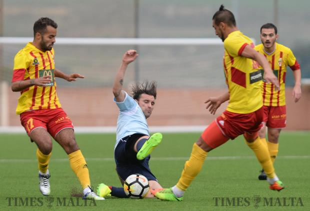 Naxxar Lions' Manolito Micallef slides in for the tackle during their BOV Premier League match against Birkirkara at the Centenary Football Stadium in Ta'Qali on February 3. Photo: Matthew Mirabelli