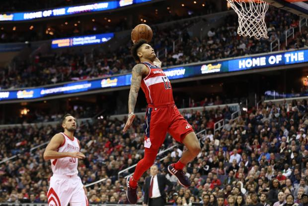 Washington Wizards forward Kelly Oubre Jr. (12) dunks the ball as Houston Rockets forward Ryan Anderson (33) looks on in the fourth quarter at Capital One Arena. The Wizards won 121-103. Photo: Geoff Burke-USA TODAY Sports