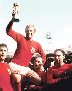 England captain Bobby Moore lifts the World Cup at Wembley Stadium.