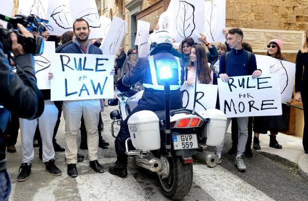 A police motor bike, escorting MEP's who were in Malta on a two-day fact-finding mission, tries to make his way through activists who gathered outside Dar l-Ewropa in Valletta calling for respect for the rule of law on December 1. Photo: Matthew Mirabelli