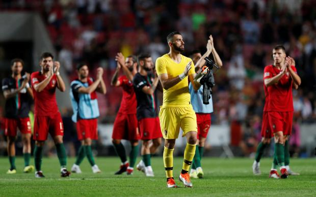 Portugal's Rui Patricio and team mates applaud fans after the match.