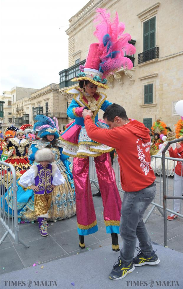 A girl is helped onto the stage as the Children's Carnival takes place in St George's Square, Valletta on February 17, a week later than planned due to bad weather. Photo: Matthew Mirabelli