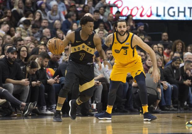 Toronto Raptors guard Kyle Lowry (7) controls a ball as Utah Jazz guard Ricky Rubio (3) defends during the fourth quarter at the Air Canada Centre. Photo Credit: Nick Turchiaro-USA TODAY Sports