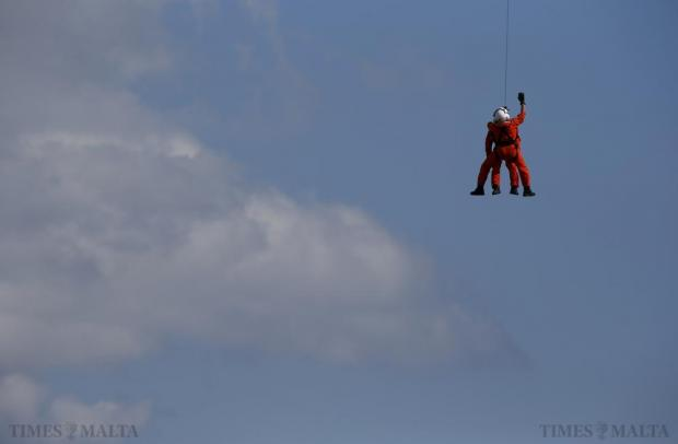 Armed Forces of Malta rescuers are hoisted up to a helicopter after a search and rescue demonstration during the Malta International Airshow on September 27. Photo: Darrin Zammit Lupi