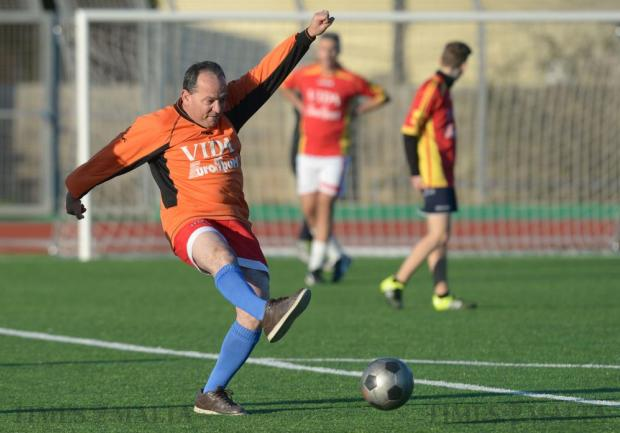 Nationalist's Party MP Chris Said kicks the ball during a charity football match at St Aloysius College in Birkirkara on 29 December. Photo: Matthew Mirabelli