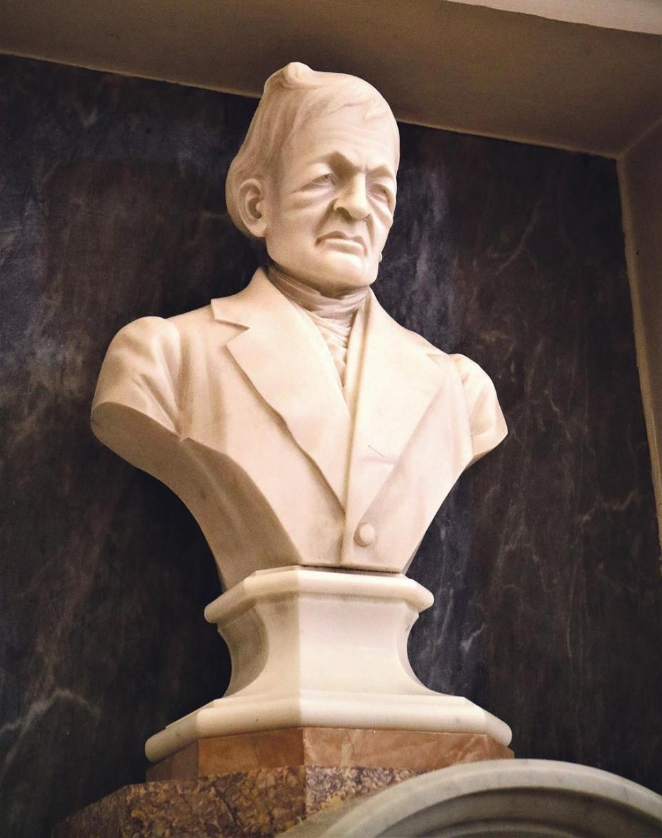 The marble bust of the architect, Giorgio Grognet de Vassé, above his tombstone close to the left front doorway at the Mosta Rotunda.