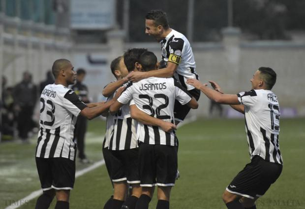 Hibernians captain Andrew Cohen jumps on his players to celebrate a goal scored against Balzan at Victor Tedesco stadium in Hamrun on November 23. Photo: Mark Zammit Cordina.