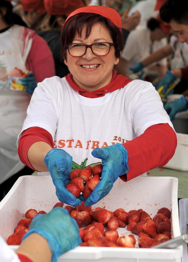 A woman handles strawberries at the Mgarr Strawberry Festival on April 2. Photo: Chris Sant Fournier