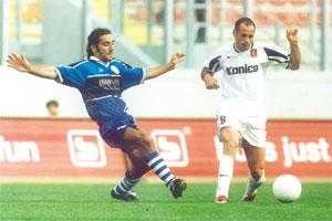 David Carabott (right) runs past Marsaxlokk`s Carmel Formosa in a Premier League match last season. The two players are likely to become team-mates as Marsaxlokk have opened talks with Valletta for Carabott.