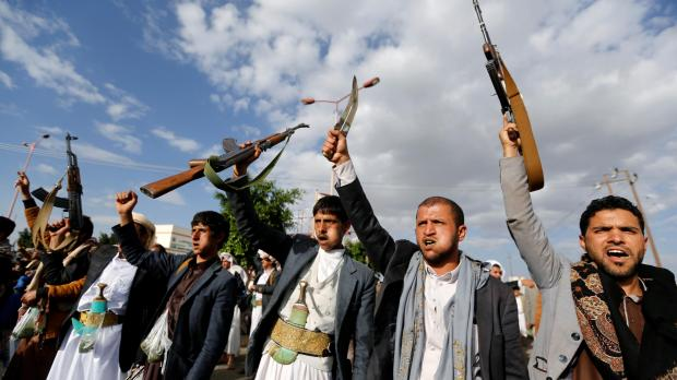 Houthi followers hold up their rifles as they shout slogans during a demonstration in Yemen. Photo: Reuters