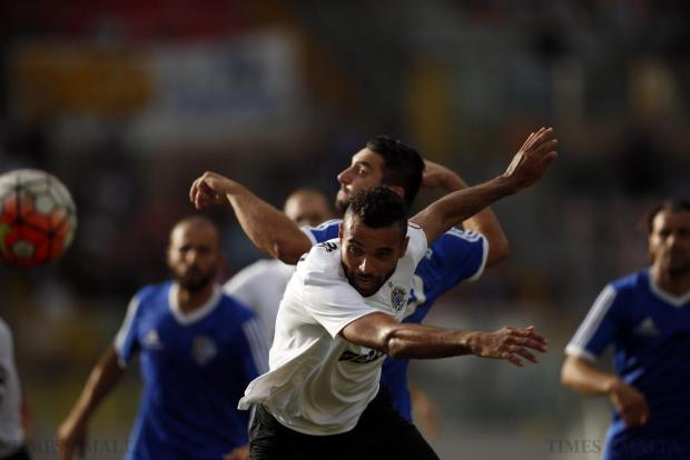 Hibernians' Rodolfo Soares (front) and Mosta's Tyrone Farrugia battle for the ball during their Premier League football match at the National Stadium in Ta'Qali on October 4. Photo: Darrin Zammit Lupi