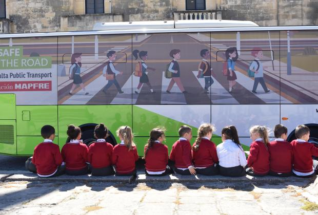 Children sit next to a Malta Public Transport Bus during a road safety campaign in Floriana on April 06. Photo: Mark Zammit Cordina