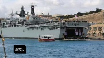 Queen and Prince Philip take harbour trip, watch horse races before leaving Malta