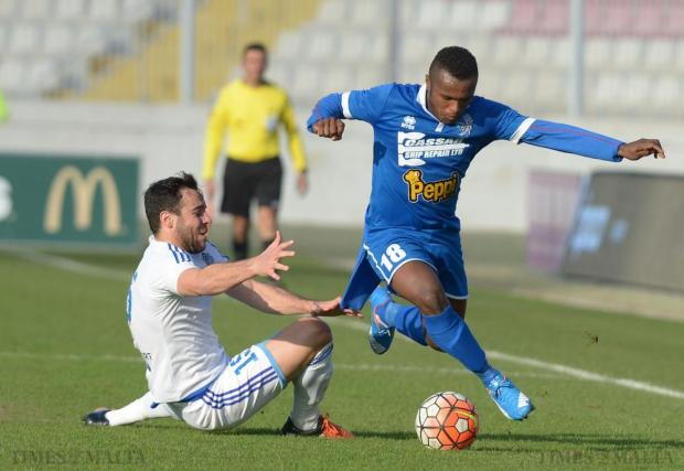 Tarxien Rainbows' Alex De Paixao Alves makes his way past Mosta's Adrian Borg during their Premier League match at the National Stadium in Ta'Qali on January 31. Photo: Matthew Mirabelli