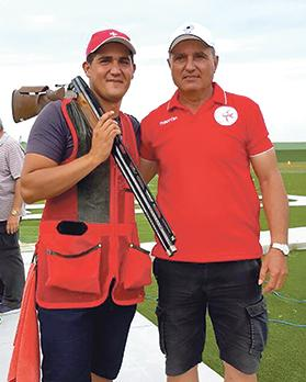 Double trap shooter William Chetcuti (left) and coach Jimmy Bugeja.