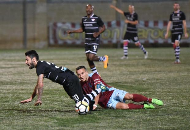 Gzira player Andrew Cohen fouls Balzan's Uros Ljubomirac at the Victor Tedesco stadium in Hamrun on October 20. Photo: Mark Zammit Cordina