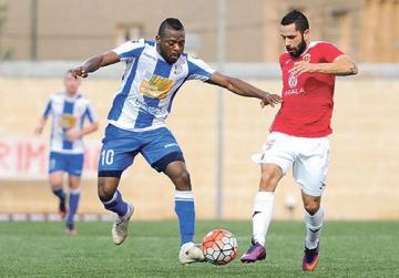 Wing battle... Mosta's Njongo Priso (left) and Valletta's Leandro Aguirre vie for possession. The game ended goalless. Photo: Steve Zammit Lupi