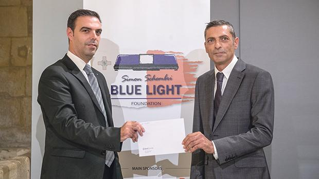 Police officer Simon Schembri (right) receives support from BNF Bank.