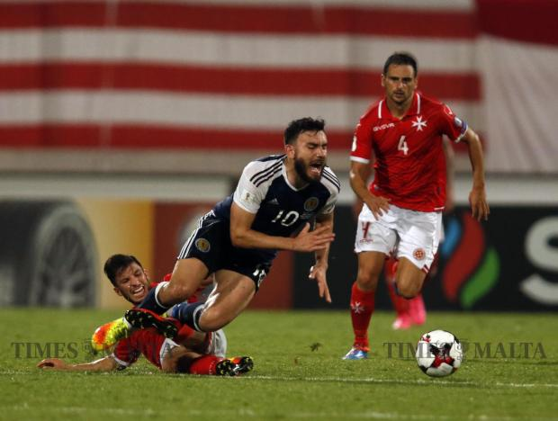 Malta's Luke Gambin makes a red-carded foul on Scotland's Robert Snodgrass during their 2018 World Cup qualifier at the National Stadium in Ta' Qali on September 4. Photo: Darrin Zammit Lupi